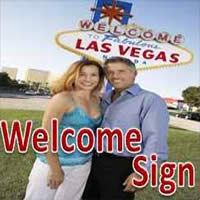 Couple in front of Welcome to Fabulous Las Vegas sign